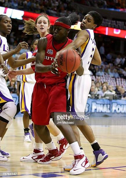 RaShonta LeBlanc of the LSU Lady Tigers attempts to strip the ball from Essence Carson of the Rutgers Scarlet Knights during the National Semifinal...