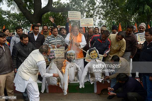 Rashtrawadi Shiv Sena leader Jai Bhagwan Goyal  and party activists burn the effigies of underworld don Dawood Ibrahim who is wanted for the 1993...