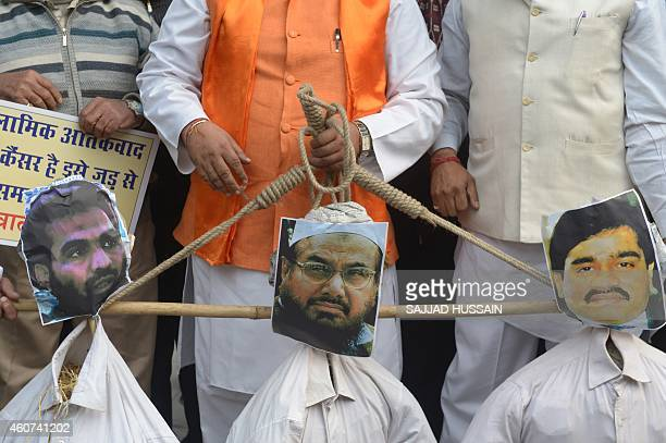 Rashtrawadi Shiv Sena leader Jai Bhagwan Goyal  holds the effigies of underworld don Dawood Ibrahim who is wanted for the 1993 Mumbai bombings...