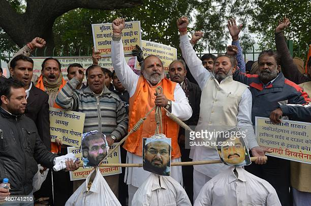 Rashtrawadi Shiv Sena leader Jai Bhagwan Goyal  with party activists holds the effigies of underworld don Dawood Ibrahim who is wanted for the 1993...