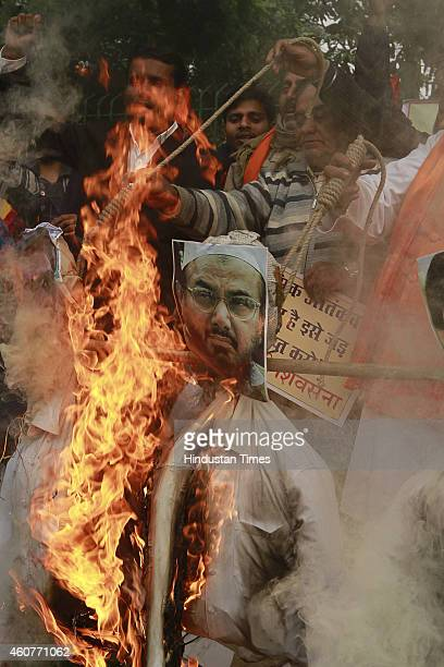 Rashtrawadi Shiv Sena leader Jai Bhagwan Goyal with supporters burn effigies of Pakistan chief of JamaatudDawa Hafiz Muhammad Saeed and a leader of...