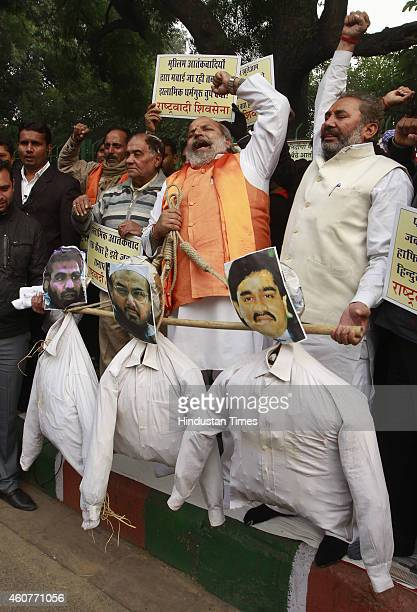 Rashtrawadi Shiv Sena leader Jai Bhagwan Goyal with supporters hold effigies of underworld don Dawood Ibrahim who is wanted for the 1993 Mumbai...