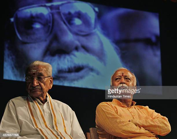 Rashtriya Swayamsevak Sangh chief Mohan Bhagwat along with VHP laeder Ashok Singhal during prayer meeting to pay tribute to late VHP leader Giriraj...