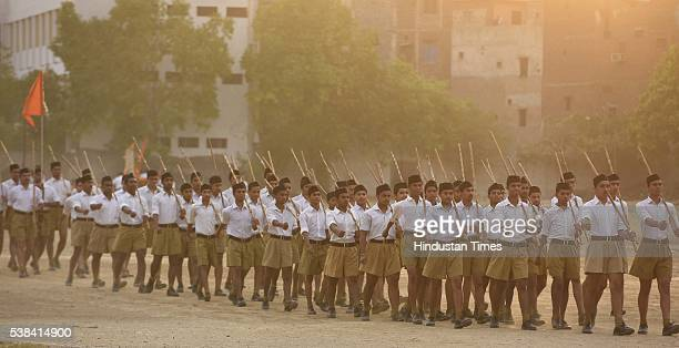 Rashtriya Swayamsevak Sangh volunteers take out parade march after a training session during a RSS Volunteer Training Camp at Gandhi Nagar on June 6...