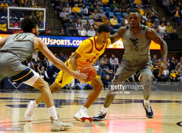 Rasir Bolton of the Iowa State Cyclones drives against Oscar Tshiebwe of the West Virginia Mountaineers at the WVU Coliseum on February 5 2020 in...