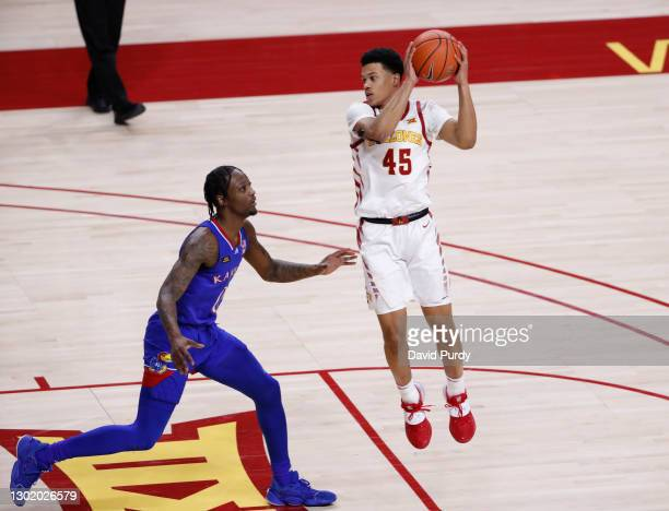 Rasir Bolton of the Iowa State Cyclones passes the ball as Marcus Garrett of the Kansas Jayhawks defends in the second half of play at Hilton...