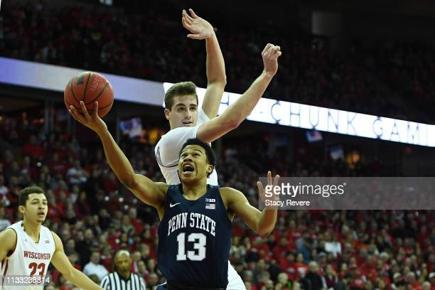 Rasir Bolton of the Penn State Nittany Lions is defended by Nate Reuvers of the Wisconsin Badgers during the first half of a game at Kohl Center on...