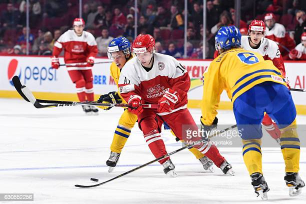 Rasmus Andersson of Team Denmark and Tim Soderlund of Team Sweden skate after the puck during the IIHF preliminary round game at the Bell Centre on...