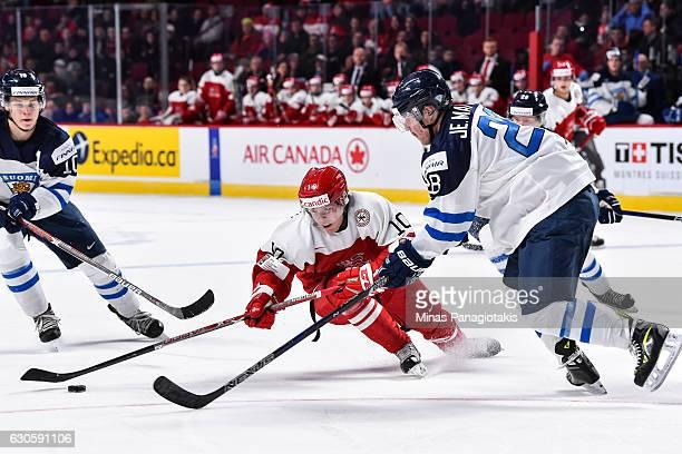 Rasmus Andersson of Team Denmark slips as he skates the puck against Jesper Mattila of Team Finland during the IIHF World Junior Championship...