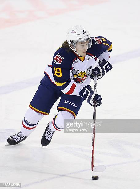 Rasmus Andersson of the Barrie Colts skates with the puck during an OHL game against the Niagara IceDogs at the Meridian Centre on March 5 2015 in St...