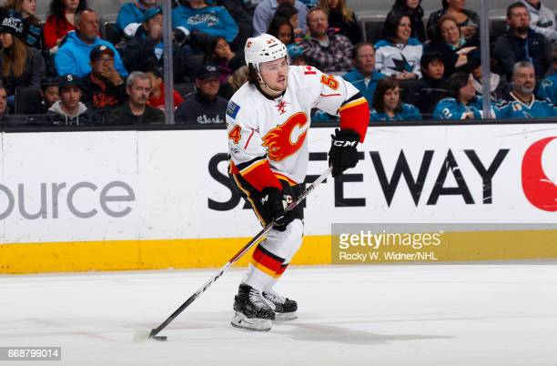 Rasmus Andersson of the Calgary Flames skates with the puck against the San Jose Sharks at SAP Center on April 8 2017 in San Jose California