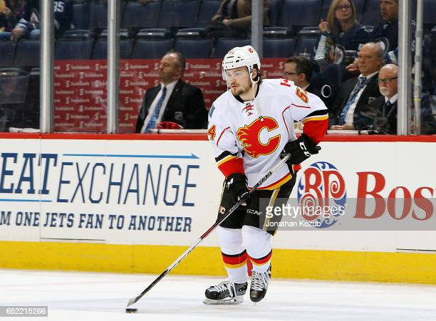 Rasmus Andersson of the Calgary Flames takes part in the pregame warm up prior to NHL action against the Winnipeg Jets at the MTS Centre on March 11...