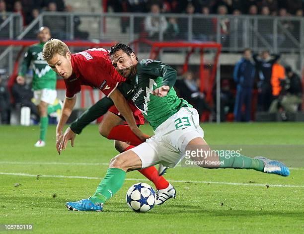 Rasmus Bengtsson of Enschede challenges Hugo Almeida of Bremen during the UEFA Champions League group A match between FC Twente and SV Werder Bremen...