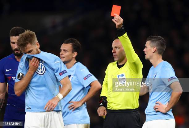 Rasmus Bengtsson of Malmo is shown a red card by referee Orel Grinfeld during the UEFA Europa League Round of 32 Second Leg match between Chelsea and...