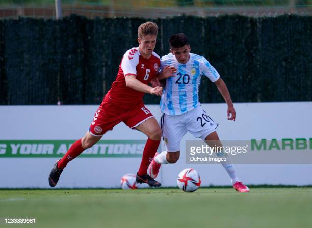 Rasmus Cartensen of Denmark Under-21 and Thiago Almada of Argentina Under-23 battle for the ball during the international friendly match between...