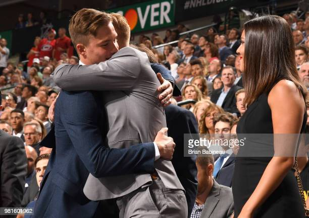 Rasmus Dahlin hugs fellow prospect Andrei Svechnikov after Dahlin was selected first overall by the Buffalo Sabres during the first round of the 2018...