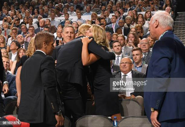 Rasmus Dahlin is hugged by a family member after being selected first overall by the Buffalo Sabres during the first round of the 2018 NHL Draft at...