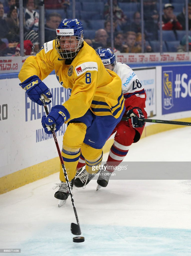 Rasmus Dahlin #8 of Sweden with the puck as Petr Kodytek #28 of Czech Republic pursues in the second period during the IIHF World Junior Championship at KeyBank Center on December 28, 2017 in Buffalo, New York.