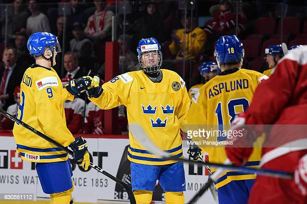 Rasmus Dahlin of Team Sweden celebrates his goal with teammates during the IIHF preliminary round against Team Denmark game at the Bell Centre on...