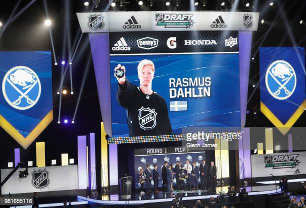 Rasmus Dahlin poses for a photo onstage after being selected first overall by the Buffalo Sabres during the first round of the 2018 NHL Draft at...