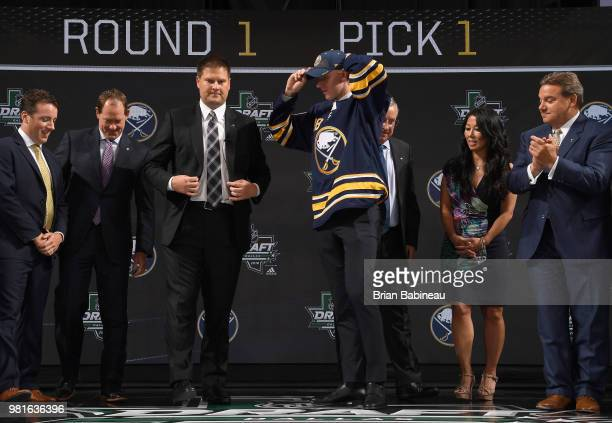 Rasmus Dahlin puts on a hat onstage after being selected first overall by the Buffalo Sabres during the first round of the 2018 NHL Draft at American...