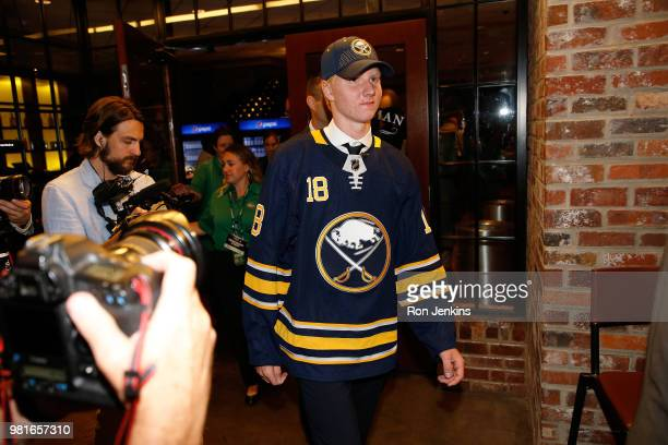 Rasmus Dahlin reacts after being selected first overall by the Buffalo Sabres during the first round of the 2018 NHL Draft at American Airlines...
