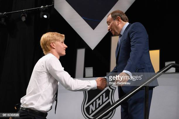 Rasmus Dahlin shakes the hand of NHL Commissioner Gary Bettman after being selected first overall by the Buffalo Sabres during the first round of the...