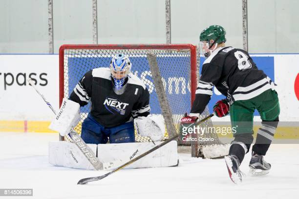TORONTO ON JULY Rasmus Dahlin takes a shot on goalie Jacob Ingham during the practice Don Meehan's agency Newport Sports Management held a camp camp...