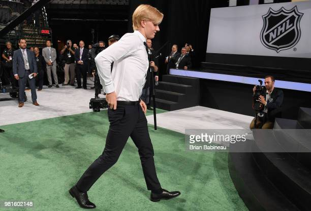 Rasmus Dahlin walks to the stage after being selected first overall by the Buffalo Sabres during the first round of the 2018 NHL Draft at American...