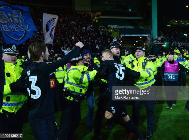 Rasmus Falk and Victor Nelson of FC Kobenhavn are help back by officers from police Scotland as they try to celebrate with the fans during the UEFA...