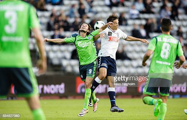 Rasmus Falk Jensen of OB and Alexander Juel Andersen of AGF compete for the ball during the Danish Alka Superliga match between AGF Aarhus and OB...