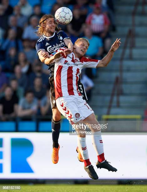 Rasmus Falk of FC Copenhagen and Kasper Kusk of AaB Aalborg compete for the ball during the Danish Alka Superliga match between AaB Aalborg and FC...
