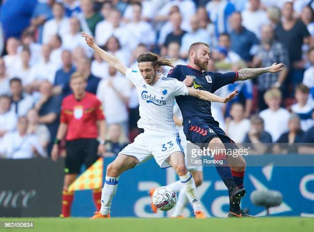 Rasmus Falk of FC Copenhagen and Martin Spelmann of AGF Aarhus compete for the ball during the Danish Alka Superliga Europa League Playoff match...
