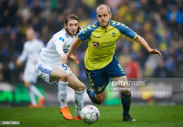 Rasmus Falk of FC Copenhagen and Teemu Pukki of Brondby IF compete for the ball during the Danish Alka Superliga match between Brondby IF and FC...