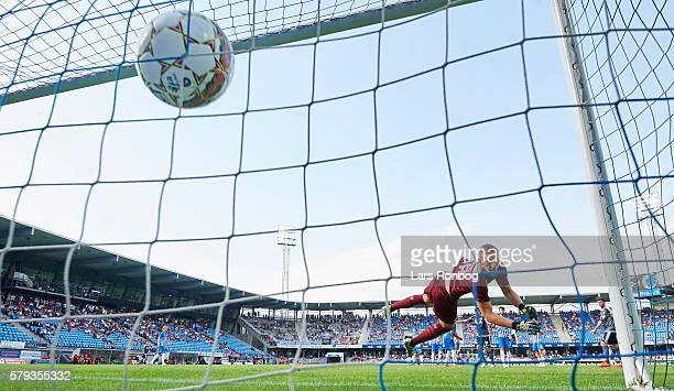 Rasmus Falk of FC Copenhagen scores the 20 goal against Goalkeeper Jeppe Hojbjerg of Esbjerg fB during the Danish Alka Superliga match between...