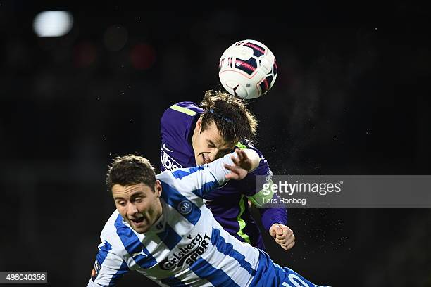 Rasmus Festersen of OB Odense and Erik Sviatchenko of Midtjylland compete for the ball during the Danish Alka Superliga match between OB Odense and...