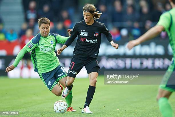 Rasmus Festersen of OB Odense and Kristoffer Olsson of FC Midtjylland compete for the ball during the Danish Alka Superliga match between FC...