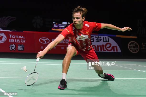Rasmus Gemke of Denmark hits a return against Kento Momota of Japan during their men's singles semifinal match at the Fuzhou China Open badminton...