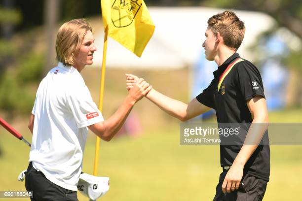 Rasmus Hojgaard of Denmark and Nick Bachem of Germany greet on the 18th hole during the third round of the 2017 TOYOTA Junior Golf World Cup at the...