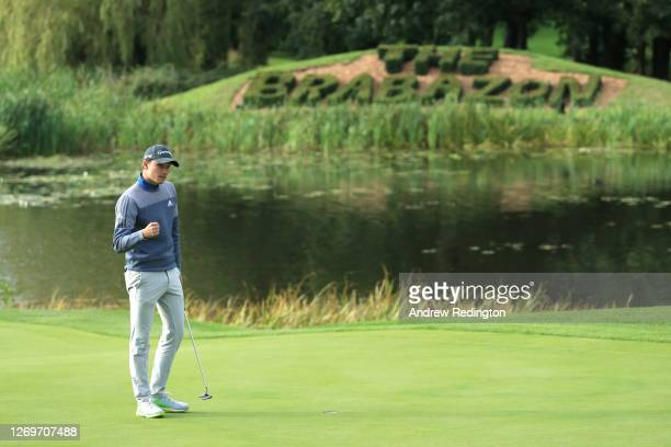 Rasmus Hojgaard of Denmark celebrates victory on the 18th green after the second play off hole during Day 4 of the ISPS HANDA UK Championship at The...
