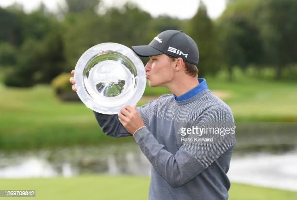 Rasmus Hojgaard of Denmark celebrates with the trophy after victory during Day 4 of the ISPS HANDA UK Championship at The Belfry on August 30, 2020...