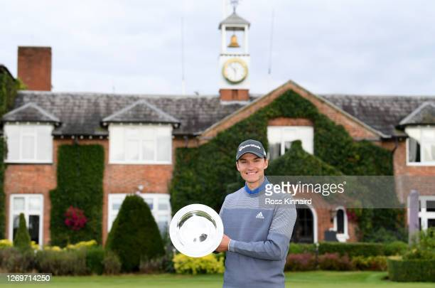 Rasmus Hojgaard of Denmark with the winners trophy after the final round of the ISPS HANDA UK Championship at The Belfry on August 30, 2020 in Sutton...