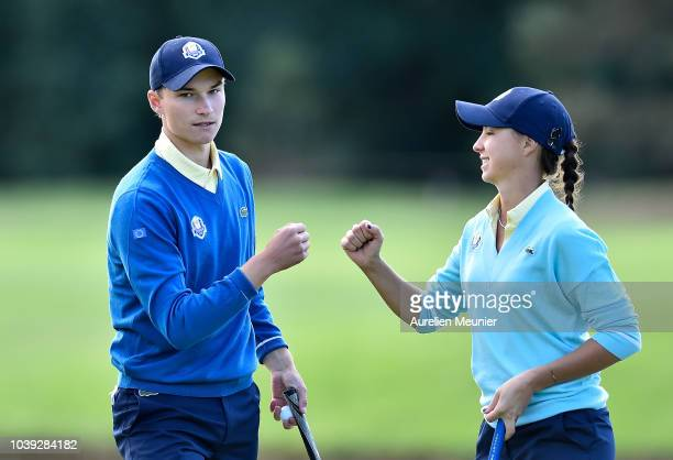 Rasmus Hojgaard of Team Europe and Emilie Alba Paltrinieri celebrate during the fourballs on day one of the 2018 Junior Ryder Cup at Disneyland Paris...