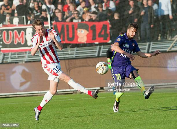 Rasmus Jönsson of AaB Aalborg and Filip Novak of FC Midtjylland in action during the Danish Alka Superliga match between AaB Aalborg and FC...