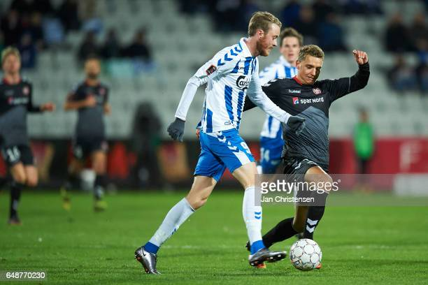 Rasmus Jönsson of OB Odense and Rasmus Thellufsen of AaB Aalborg compete for the ball during the Danish Alka Superliga match between OB Odense and...