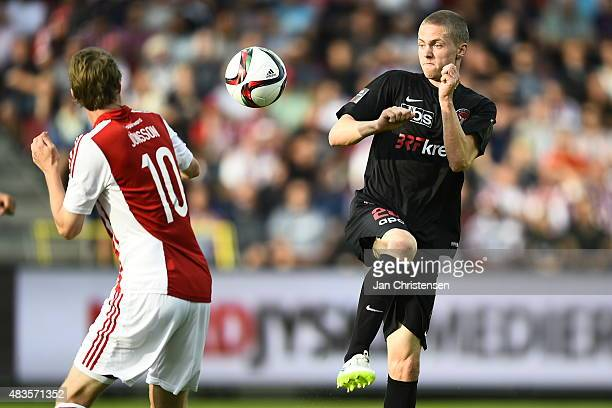 Rasmus Jonsson of AaB Aalborg and André Romer of FC Midtjylland compete for the ball during the Danish Alka Superliga match between AaB Aalborg and...