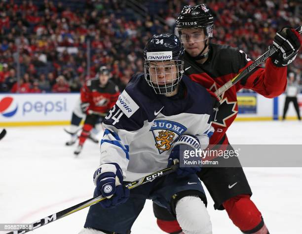 Rasmus Kupari of Finland and Brett Howden of Canada fight for position during the second period at KeyBank Center on December 26 2017 in Buffalo New...