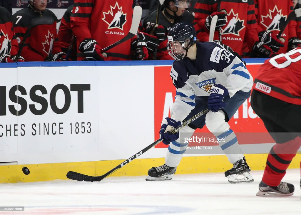 Rasmus Kupari #34 of Finland skates up ice with the puck during the second period against Canada at KeyBank Center on December 26, 2017 in Buffalo, New York.