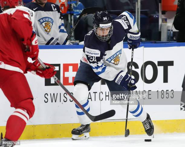 Rasmus Kupari of Finland skates up ice with the puck in the second period against Denmark during the IIHF World Junior Championship at KeyBank Center...