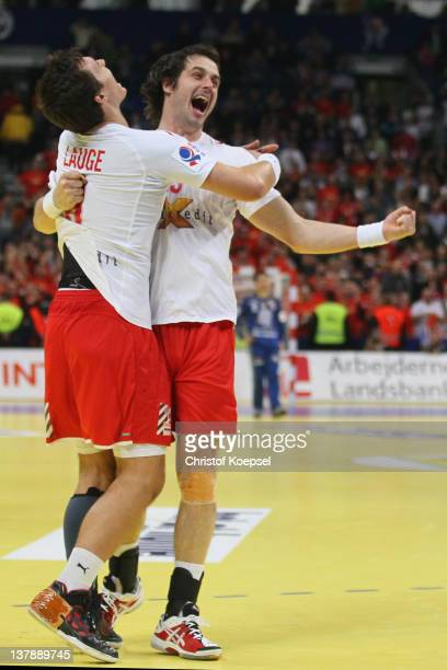 Rasmus Lauge and Bo Spellerberg of Denmark celebrate the 21-19 victory after the Men's European Handball Championship final match between Serbia and...
